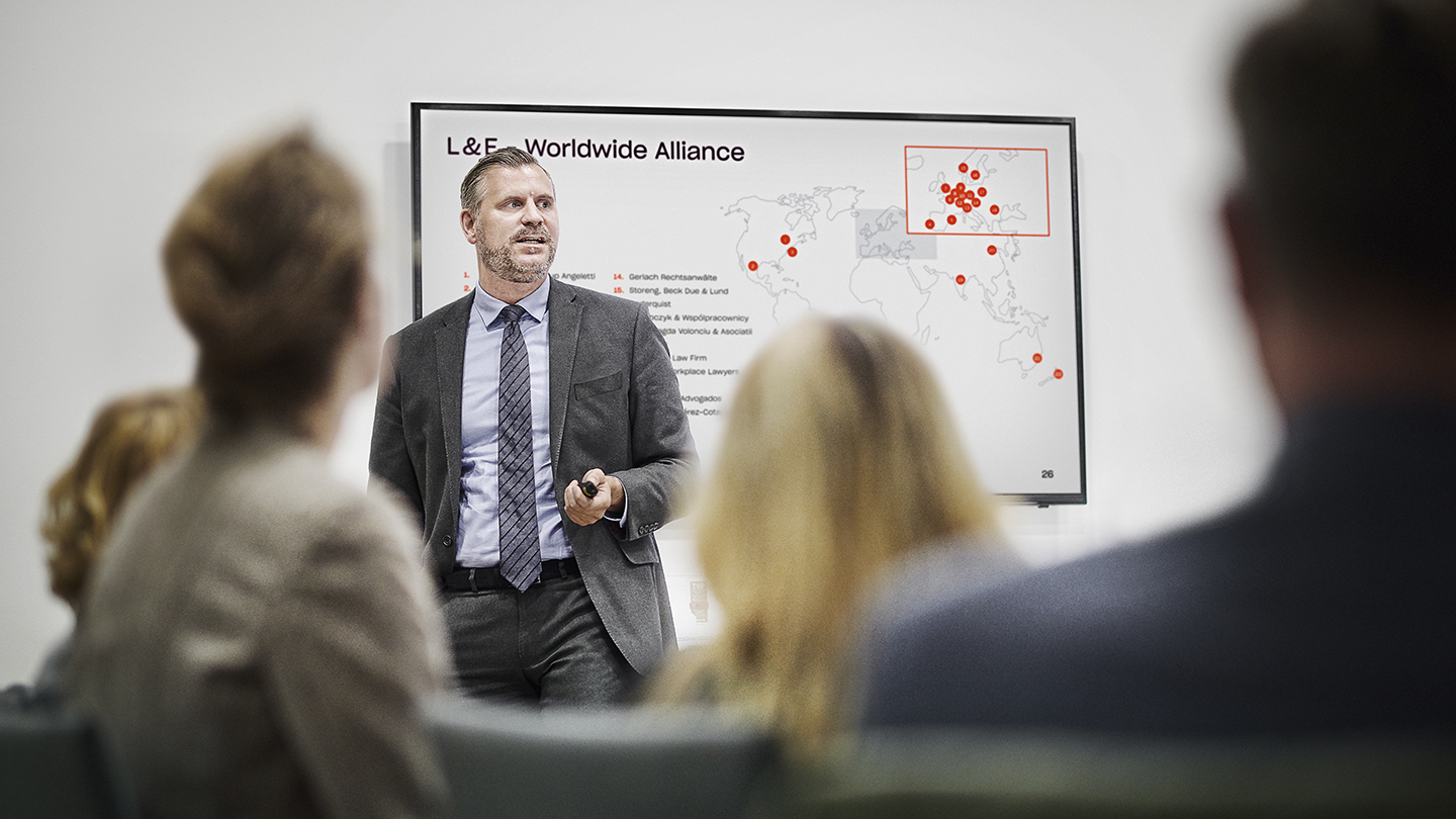 Man presenting in front of group of people