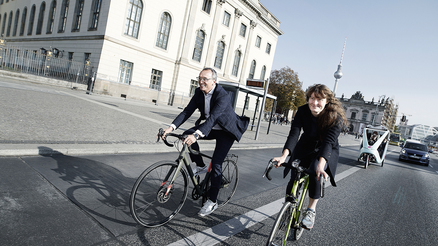 Man and woman riding bicycles in Berlin